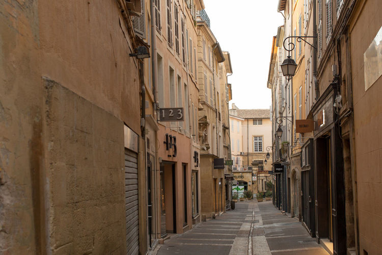 A narrow street at the Old city, Aix-en-Provence Alley Architecture Building Building Exterior Built Structure City Day Diminishing Perspective History Leading Long Narrow No People Old Town Outdoors Residential District Sky The Way Forward Walkway