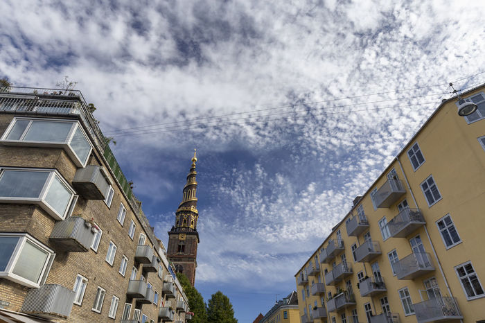 Apartments near the spire of the Church of our Savior in Copenhagen, Denmark. Architecture Denmark Scandinavia Statue Swimming Tourist Attraction Canal Church Of Our Saviour Copenhagen Danish Destination Historical History Landscape Nyhavn Outdoors Red Fort Relax Rundetaarn Spire  Summer Swim Tourism Traditional
