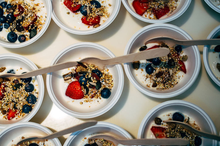 High Angle View Of Fresh Breakfast Cereal Served In Bowls On Table