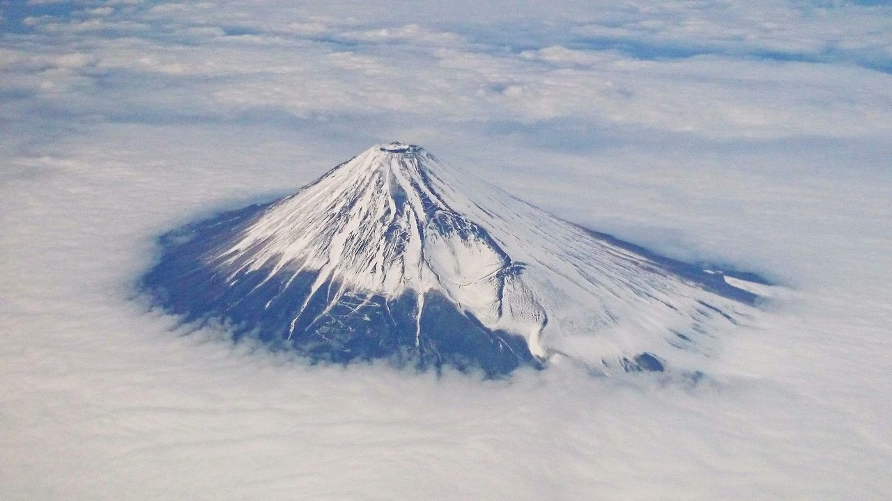 High Angle View Of Mt Fuji Against Cloudy Sky