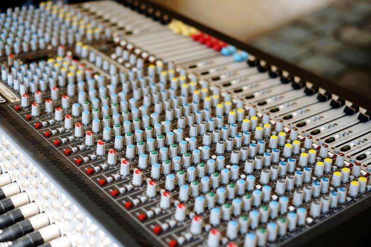 High angle close-up of sound mixer at studio