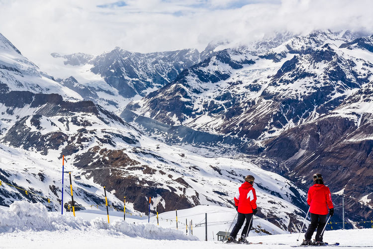Ready to go down the slope Adventure Beauty In Nature Cold Temperature Leisure Activity Mountain Mountain Range Rear View Season  Ski Skiing Snow Snowcapped Mountain Sport Travel Winter Winter Sport The Color Of Sport Alps Slope People And Places People