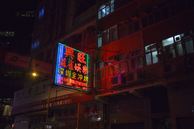 Hong Kong HongKong Advertisement Architecture Building Building Exterior Built Structure City City Life Commercial Sign Communication Illuminated Low Angle View Neon Night Nightlife No People Non-western Script Script Sign Store Sign Street Text Western Script