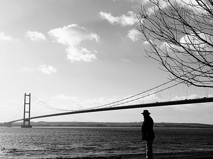 Black And White Silhouette Man In Hat Humber Bridge Looking Over Water Hull City Of Culture 2017 Riverside Winter Sky