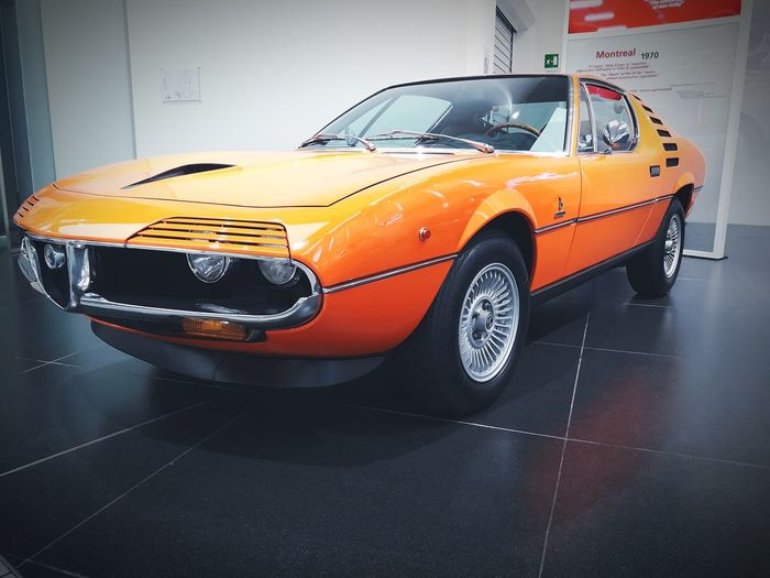 Alfa Romeo EyeEmNewHere Transport Alfaromeomontreal Alfaromeomuseum Alfa Romeo Orange Color Orange Orangecar Car Yellow Alfaromeo Alfa Yellowcar Transportation Wet Collector's Car No People Indoors  Land Vehicle Mode Of Transport Stationary Day