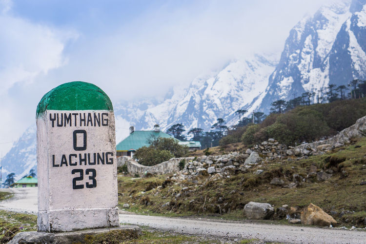 Beauty In Nature Close-up Cold Temperature Communication Day Lachung Landscape Milestone Mountain Mountain Range Nature No People Outdoors Sky Snow Text Yumthang Valley