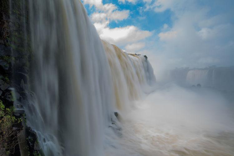 Idyllic view of iguazu falls against sky