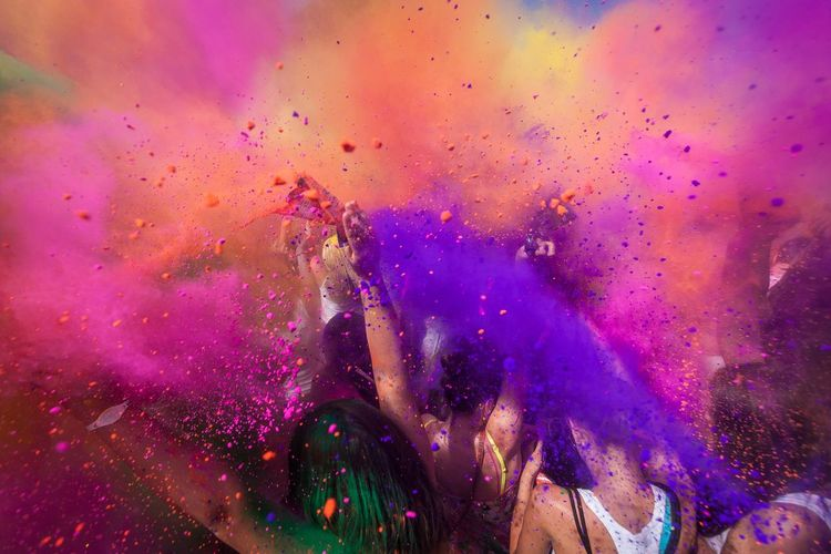 People Throwing Powder Paint During Holi Celebration