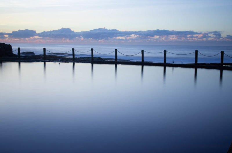 Architecture Beauty In Nature Bridge Bridge - Man Made Structure Built Structure Cloud - Sky Connection Nature No People Outdoors Reflection Scenics - Nature Sea Sky Sunset Tranquil Scene Tranquility Water Waterfront Wooden Post