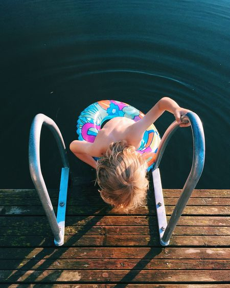 Mind over body. Nature Kids Enjoying Life Outdoors Swimming HÉSITATION