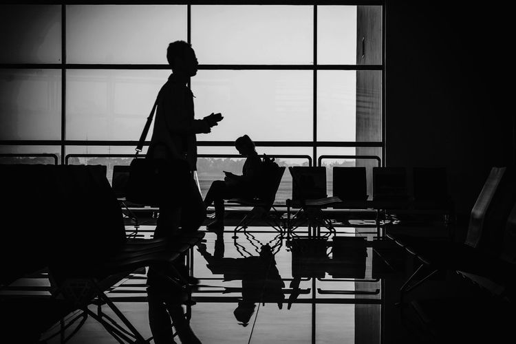 Adult Airport Chair Day Glass - Material Indoors  Lifestyles Men Occupation People Real People Seat Side View Silhouette Standing Transparent Transportation Two People Waiting Window Women