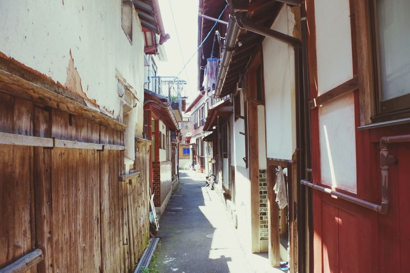 Alley amidst houses in city
