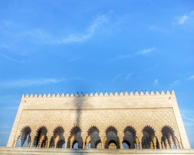 Low Angle View Of Mausoleum Of Mohammed V Against Sky
