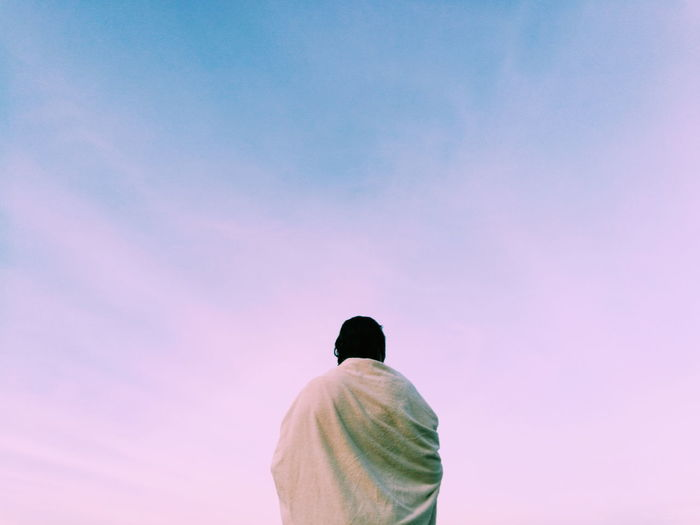 Low Angle View Of Man Against Pink Sky
