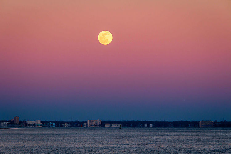 Sky Scenics - Nature Sunset Architecture Beauty In Nature Full Moon Nature Dusk Moon No People Tranquility Building Exterior Landscape Built Structure Tranquil Scene Outdoors Sea Transportation Night City Purple