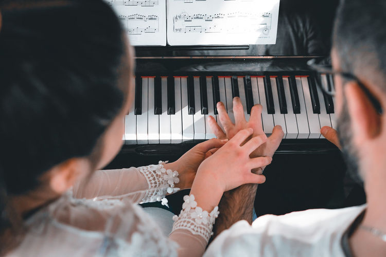Home G Portrait Natural Light People Piano Real People Music Musical Equipment Musical Instrument Playing Group Of People Indoors  Men Lifestyles Women Adult Rear View Arts Culture And Entertainment Selective Focus Piano Key Leisure Activity Togetherness Human Hand