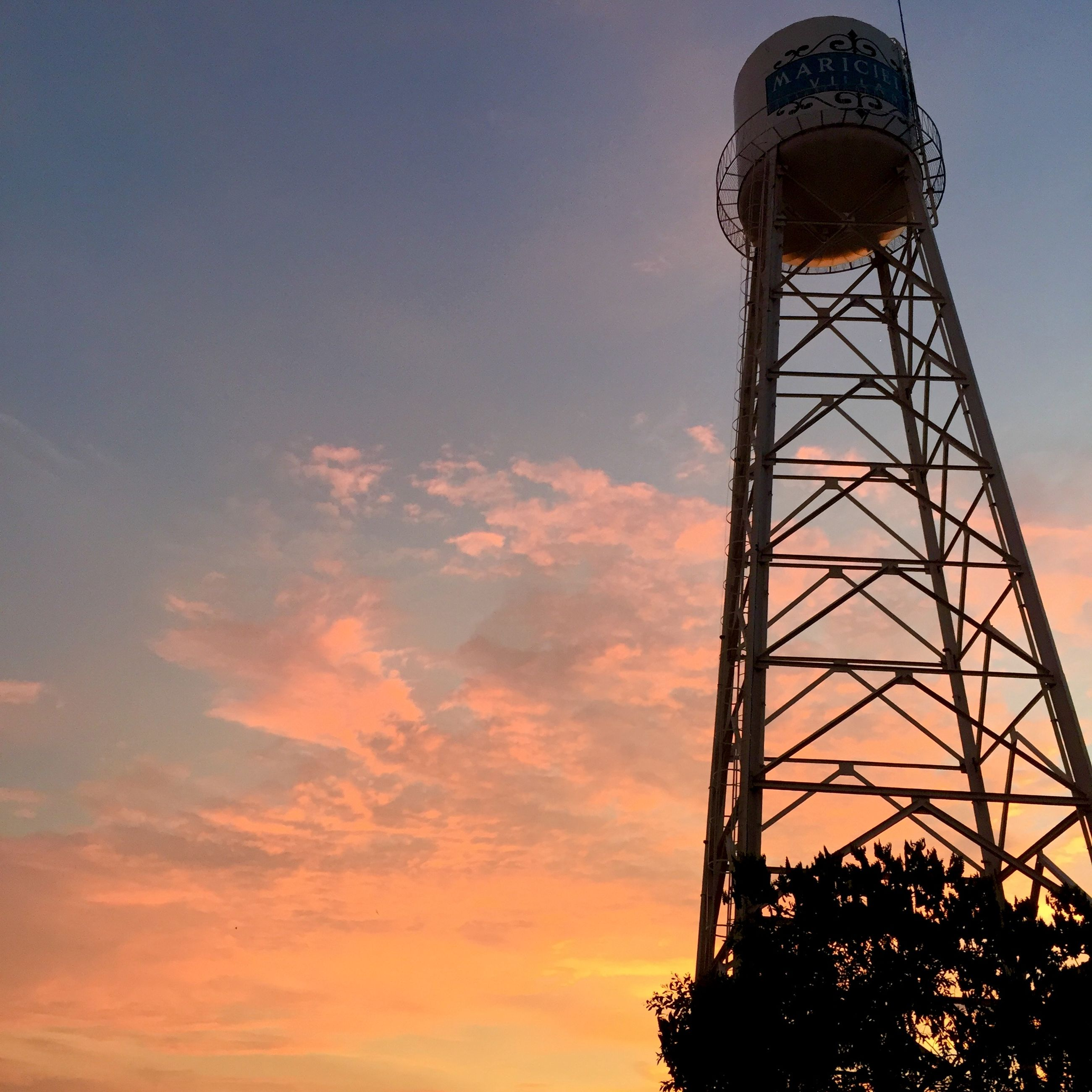 low angle view, sky, built structure, architecture, sunset, tower, cloud - sky, silhouette, tall - high, dusk, building exterior, amusement park, cloud, outdoors, orange color, metal, communications tower, no people, cloudy, nature