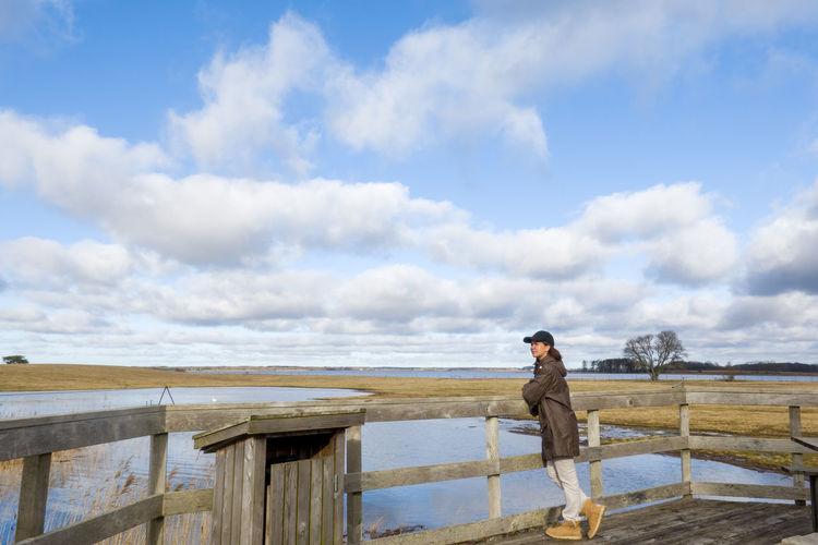Man on shore against sky