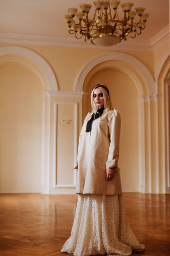 Architecture Dressed Up Fashion Golden Arch Architecture Editorial  Full Length Home Interior Indoors  Lifestyles Looking At Camera Luxury Magazine Portrait Real People Standing Style Style And Fashion White White Clothes Yellow Fashion Stories