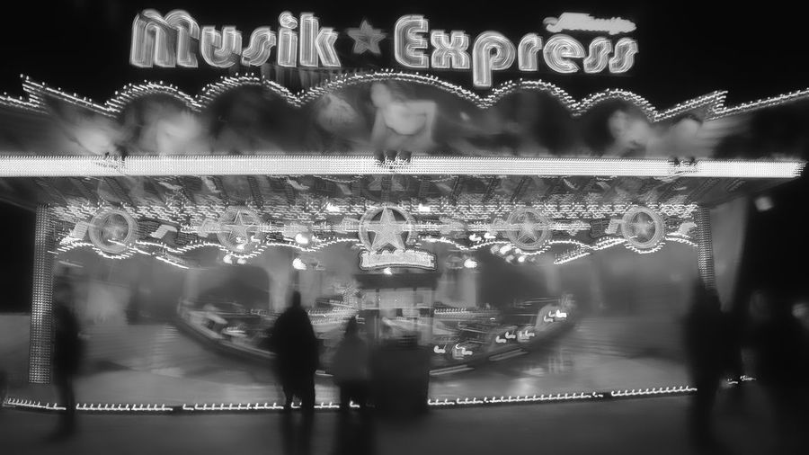 music Express luna park1 Night Text Illuminated No People Arts Culture And Entertainment Luna Park Motion Lighting Equipment Unrecognizable People Fast Fun Outdoors Western Script Blurred Motion Amusement Park Ride Carousel Black & White