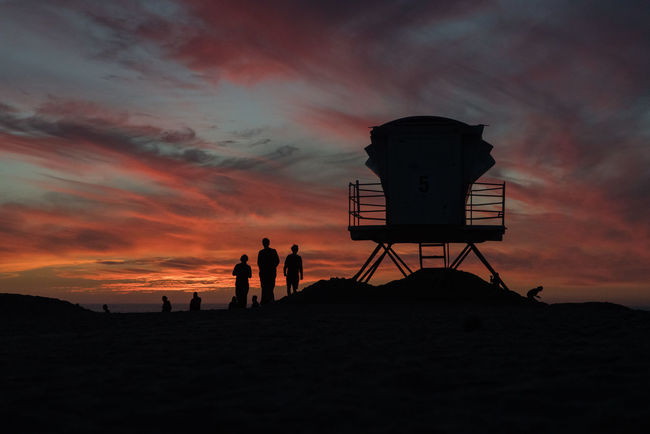 Sunset silhouettes of lifeguard hut and beachgoers in Ocean Beach of San Diego, California Cali California Calm San Diego Sunset_collection Travel Vacations Beach Lifecoach Lifeguard  Lifeguard Tower Mindful Mindfulness Minimalism Sandiego Sunset Travel Blog Travel Destinations Vacation