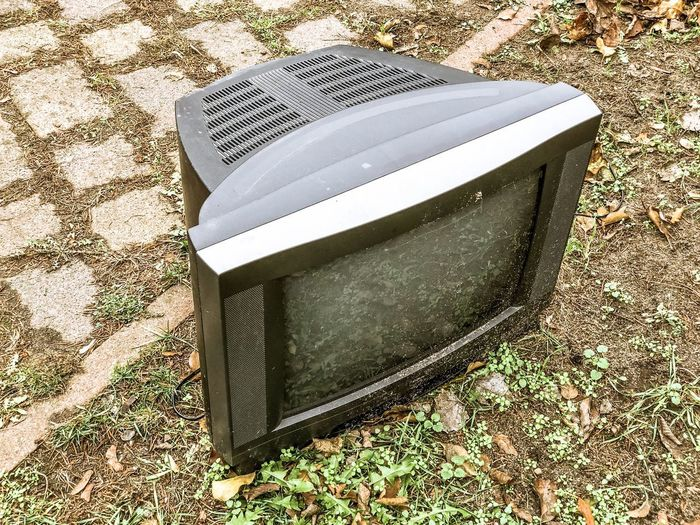 Old Television on the street Technology Replaced Not Usefull Anymore Tv Television Day No People Land High Angle View Field Outdoors Abandoned Old Still Life Obsolete