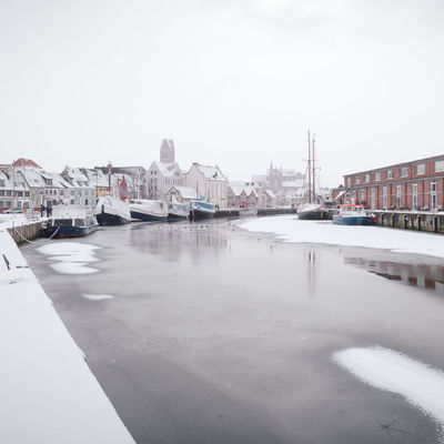 view of snow covered buildings in city Historical Building Mecklenburg-Vorpommern Winter Winterscapes Architecture Building Exterior Built Structure City Cityscape Clear Sky Cold Temperature Commercial Dock Day Germany Harbor Mode Of Transport Moored Nature Nautical Vessel No People Old Buildings Oldtown Outdoors Philipp Dase Sky Snow Covered Transportation Water Waterfront Winter Winter In The City Wismar Yacht