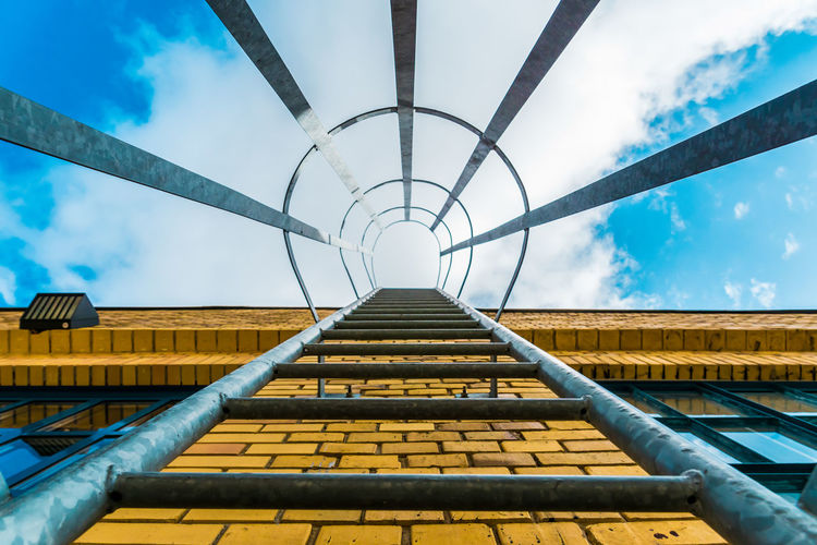 Low angle view of fire escape against sky