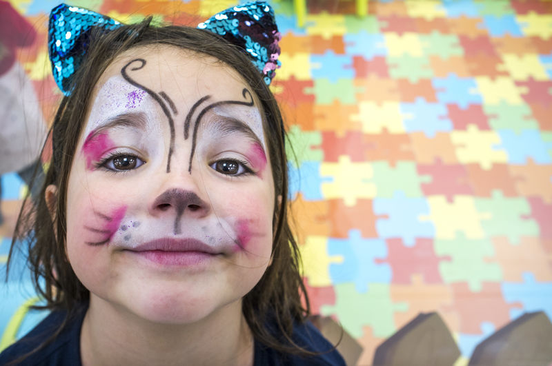 Close-up portrait of girl with face paint