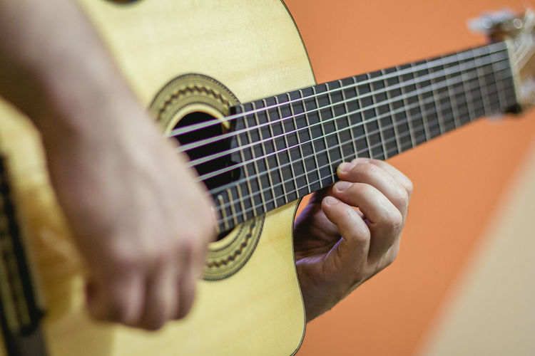Playing 7 strings acoustic guitar Adult Arts Culture And Entertainment Check This Out Close-up Finger Play Finger Style Guitar Human Hand Indoors  Men Music Musical Instrument Musical Instrument String One Person People Playing