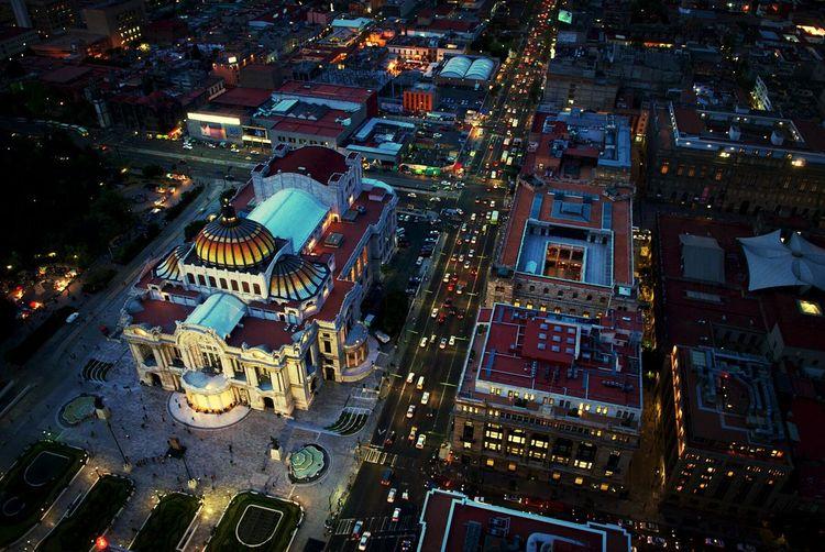 High angle view of illuminated palacio de bellas artes in city at night