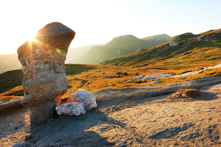 Rock formations on mountains during sunny day