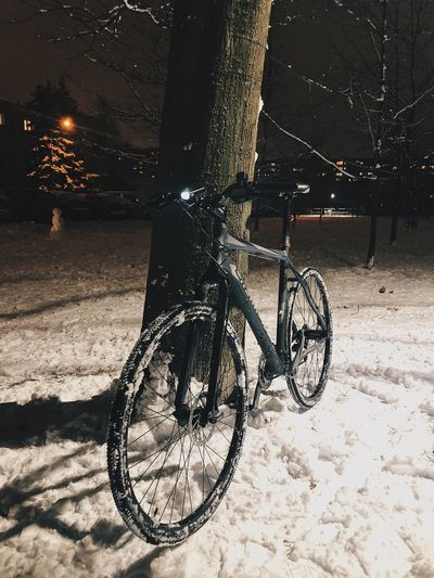 Bicycle parked on street during winter