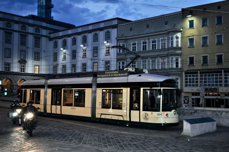 tramway Architecture Building Building Exterior Built Structure Cable Car City Illuminated Incidental People Land Vehicle Mode Of Transportation Nature Outdoors Public Transportation Rail Transportation Railroad Track Street Track Tramway Tramway Sign Tramway Station Tramways Transportation Travel Window