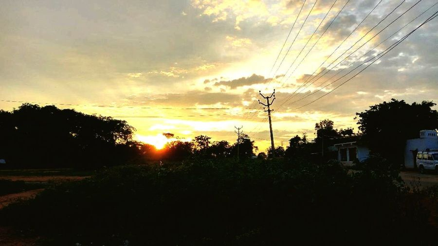 It's the sunset tym..... Sunset Tree Dramatic Sky Cloud - Sky Sky Nature Silhouette No People Beauty In Nature Outdoors Sunlight Storm Cloud Landscape Scenics Electricity Pylon Grass Day First Eyeem Photo EyeEm Diversity