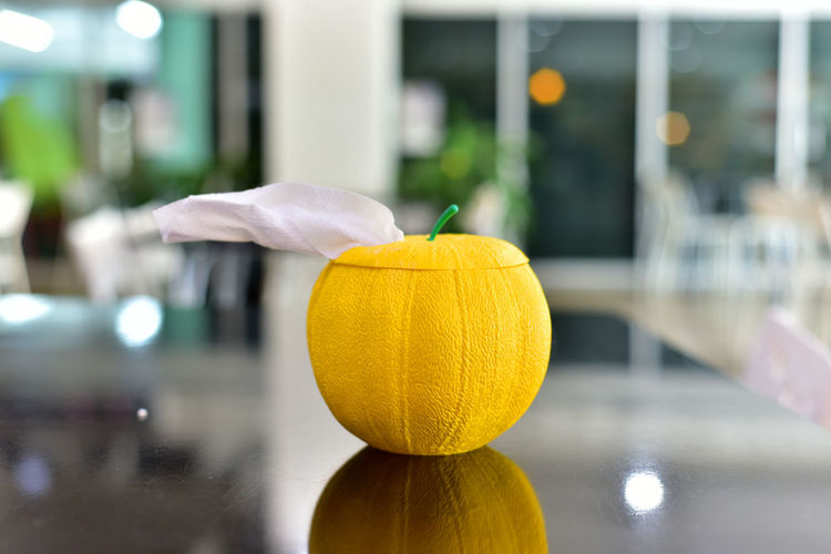 Close-up of yellow pumpkin on table