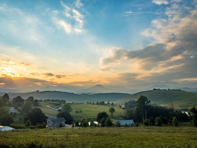 Landscape Travel Destinations Travel KwaZulu-Natal South Africa Underberg Mountains And Sky Mountains Agriculture Cloud - Sky Field Sunset Sky Beauty In Nature No People Nature Scenics Tree Rural Scene Outdoors Water Day Tea Crop Freshness