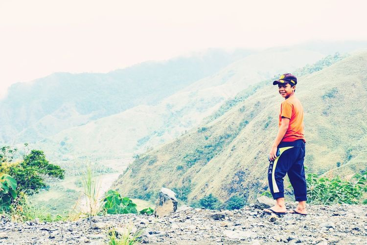 smile and let the world wonder why Photooftheday Getoutside Explorephilippines Traversephilippines Lifeinmoments Neverstopexploring  Lifeisanadventure Mountains Mountain View Cliffside One Person Sunglasses People One Boy Only Standing Casual Clothing Adult Full Length Outdoors Childhood Day Smiling