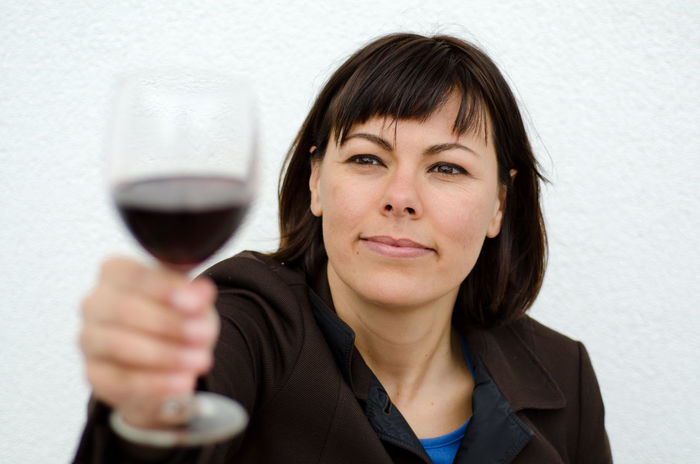 Woman Holding Up a Glass of Wine Adult Alcohol Business Businesswoman Drink Drinking Drinking Glass Food And Drink Front View Happiness Headshot Holding Holding Up Mature Adult One Person One Woman Only Only Women Portrait Red Wine Self Confidence Smiling Wine Wineglass Winetasting Women