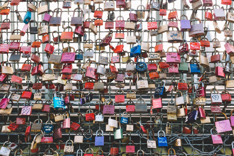 Full Frame Shot Of Colorful Padlocks Attached In Fence