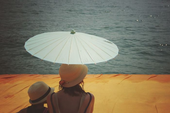 Walking on the Floating piers | Golden Moments  Mother Umbrella The Essence Of Summer Getting Inspired Point Of View Still Life People Fine Art Close-up The Innovator The Mix Up Edge Of Imagination The Floating Piers Sunshine Christo And The Floating Piers Tailored To You Original Experiences Feel The Journey Relaxing Showcase July 43 Golden Moments Lago D'Iseo EyeEm Italy |