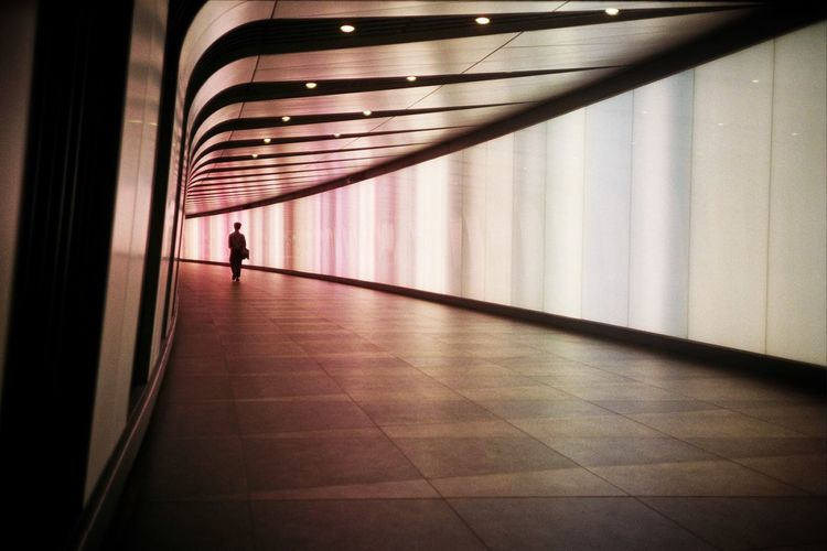 Architecture Built Structure Indoors  Walking Real People One Person Full Length The Way Forward Lifestyles Travel Tunnel Direction Illuminated Flooring Men Public Transportation Arcade Rear View Corridor Ceiling