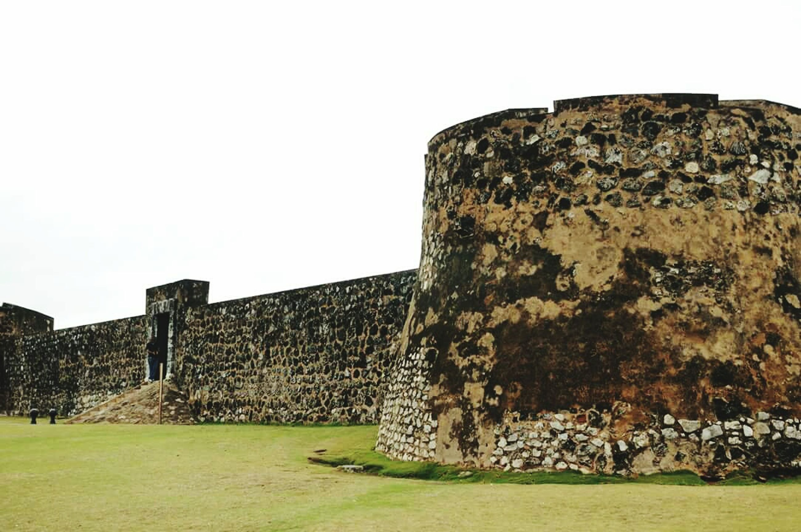 built structure, architecture, clear sky, history, grass, old ruin, building exterior, the past, stone wall, ancient, old, copy space, stone material, abandoned, damaged, sky, ancient civilization, ruined, low angle view, day