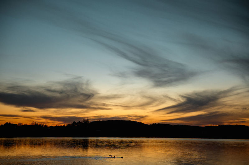 Sky Scenics - Nature Beauty In Nature Water Sunset Tranquility Cloud - Sky Tranquil Scene Lake Silhouette Nature Reflection Tree No People Orange Color Non-urban Scene Idyllic Waterfront Outdoors EyeEm Best Shots EyeEm Nature Lover EyeEm Selects