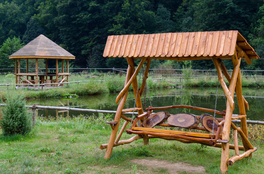 Pond Architecture Building Exterior Built Structure Day Field Grass Handmade Landscape Nature No People Old-fashioned Outdoors Tree Wood - Material Wooden Swing