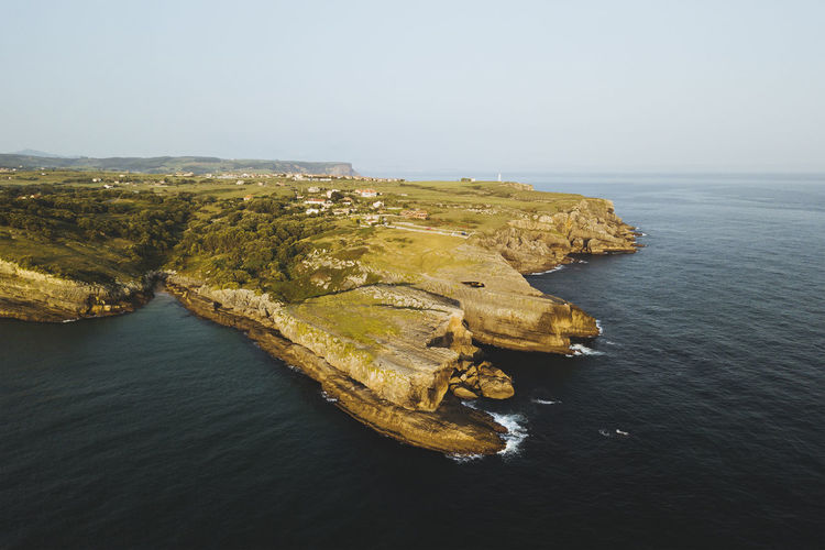 Aerial view of sea against clear sky