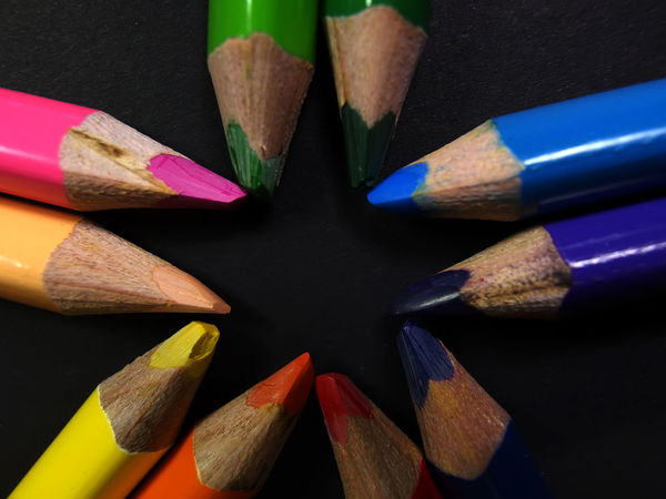 colored pencil on dark black paper Choice Close-up Colored Pencil Indoors  Large Group Of Objects Multi Colored No People Pencil Pencil Shavings Still Life Variation Variety Wood - Material Yellow