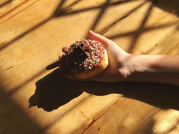 Food And Drink Food Sweet Food Indulgence Temptation Freshness Human Hand Indoors  Unhealthy Eating One Person Dessert Ready-to-eat Table Sprinkles Close-up Donut Human Body Part Holding Real People Day מייאייפון7 מייחנוכה מייפוד Dounuts Hanukkah Food Stories