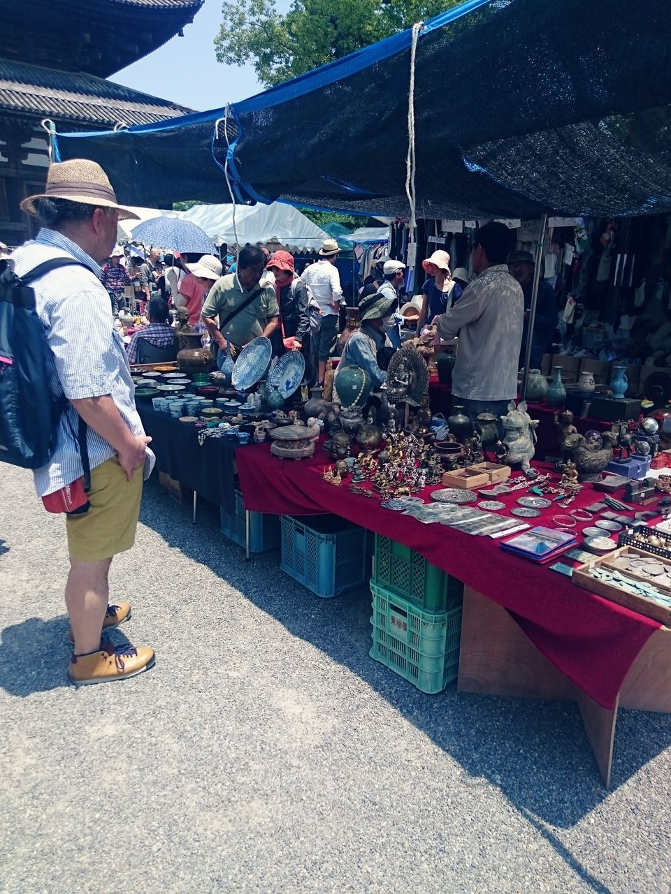 real people, market, for sale, market stall, day, large group of people, retail, outdoors, market vendor, casual clothing, men, lifestyles, full length, leisure activity, asian style conical hat, standing, occupation, food, people