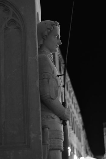 Low angle view of buddha statue at night